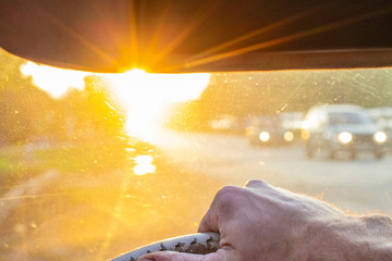 dangerous driving with blinding sun in the car windshield.background blurred with bokeh effect