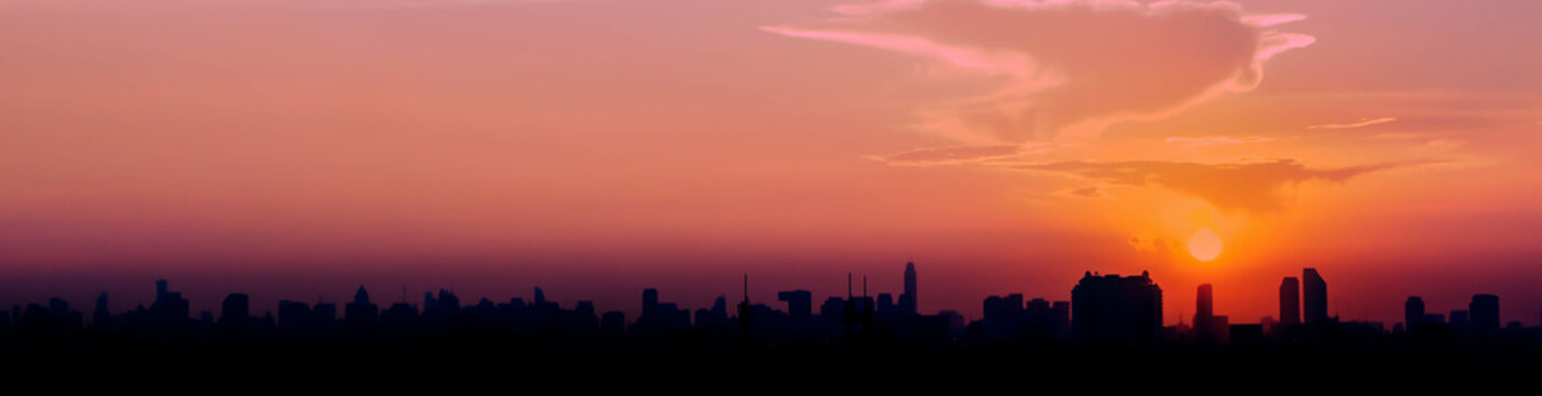 Website header or banner design of sunset in the city panoramic background
