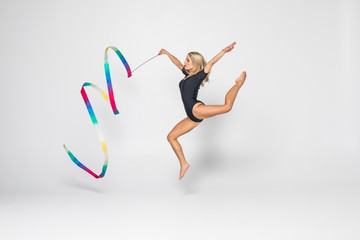 Rhythmic gymnast with gymnastics tape isolated on white background