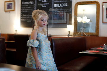 Model Daisy-May Demetre, 9 year-old double amputee who will walk the runway during Paris Fashion Week, during a photo shoot a day before the luxury children's wear label Lulu et Gigi show in Paris