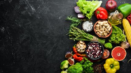 Foto op Aluminium Eten Organic food. Fresh vegetables and fruits. Top view. Free copy space.