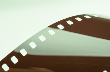 Strip of glossy film abstract close-up, soft focus
