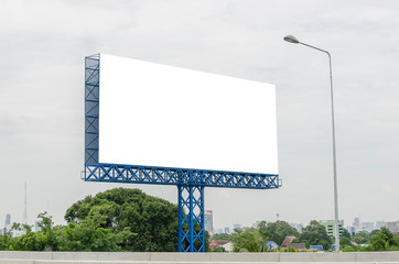 The large blank billboard with the sky, ready to use for new mockup advertisement, marketing street media and backgroud concept