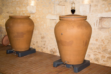 Fototapeta winery in Bordeaux france with modern clay amphora potsstored wine to age obraz