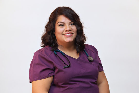 Portrait of a young attractive female hispanic healthcare professional