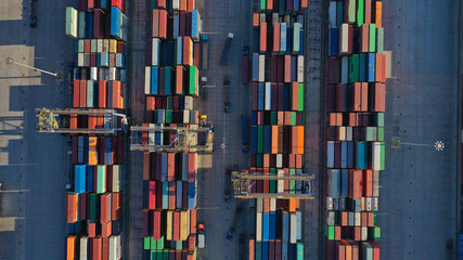 Aerial top down photo of containers in ship port for business Logistics and transportation of Container Cargo, logistic import export and transport