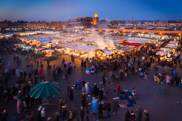 Crowd in Jemaa el Fna square at sunset, Marrakesh, Morocco. People blur to imply their movements.