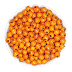 Firethorn fruits in white bowl. Fresh and ripe orange colored seeds of Pyracantha. The fruit can be made into jelly. Bird food. Closeup, from above, on white background, isolated macro food photo.