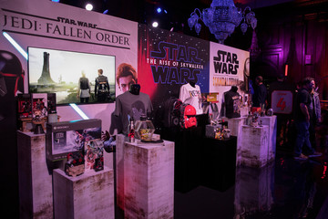 Visitors look at merchandise on display at the announcement of new Star Wars products at Pinewood Studios, Iver Heath