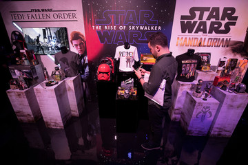 A visitor looks at merchandise on display at the announcement of new Star Wars products at Pinewood Studios, Iver Heath