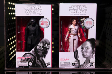 Kylo Ren and Rey toys from Star Wars: Rise of Skywalker sit on display at the announcement of new Star Wars products at Pinewood Studios, Iver Heath