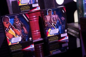 A Chewbacca and Finn toys sit on display at the announcement of new Star Wars products at Pinewood Studios, Iver Heath