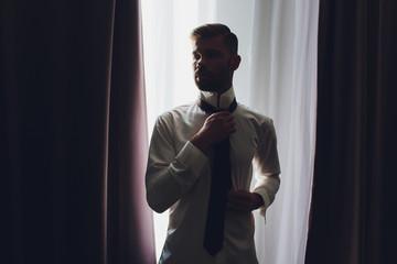 groom in a jacket, the groom fastens his jacket, The morning of the groom, bridegroom's fees.