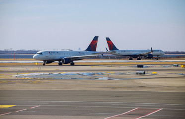 DELTA aircraft at the John F. Kennedy International Airport. It is the busiest international air passenger gateway in the U.S.