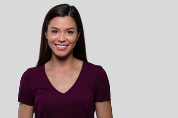 Commercial headshot advertising portrait of a beautiful young asian american brunette woman with perfect white teeth smile