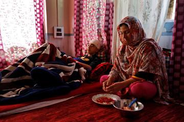 The Wider Image: Barricades and books in restive Kashmir neighbourhood