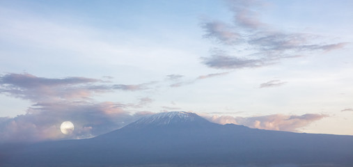 Wall Mural - Mount Kilimanjaro Snow-Capped Peak With Full Moon