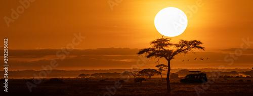 Wall mural Orange Sunset Safari Vehicle Horizontal Web Banner