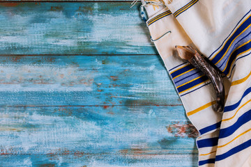 Shofar horn and tallit jewish holiday with hassidic Jews pray