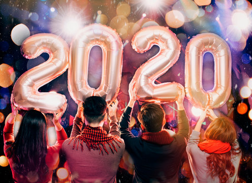 happy young group celebrating new year 2020 party