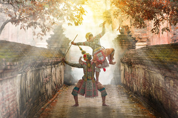 Khon is art culture Thailand Dancing in masked Ramakien ,Hanuman and tos-sa-kan are Dancing in literature Ramayana.Khon is thailand culture and traditional sunlight background. Wall mural