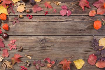 autumn leaves on darrk old wooden background