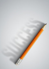 Business success creative concept, pencil with success shadow