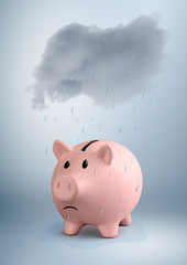 savings at risk concept, piggy bank in the rain
