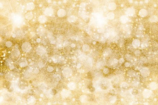 Golden glittering pattern. Festive background. Shimmering sparkles