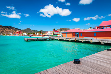 Wall Mural - Philipsburg, St Maarten (Sint Maarten, Saint Martin), Caribbean. Wooden dock and colorful buildings at Great Bay beach. Popular cruise destination.