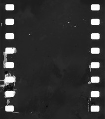 original filmstrip with empty dusty frames or cells and nice texture on the border, fluffs on film material, real film grain