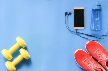 Sport accessories on blue background