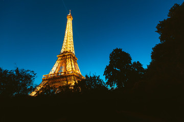 28 July 2019, Paris, France: Illuminated Eiffel tower at night
