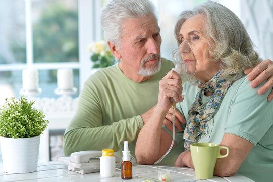 Close-up portrait of an elder couple making inhalation
