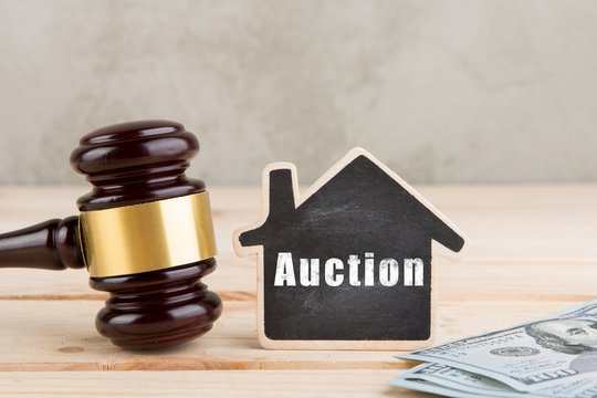 Real estate concept auction gavel and little house with inscription Auction