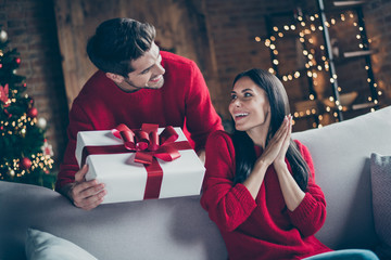 Portrait of his he her she nice attractive lovely sweet charming cheerful cheery glad married spouses guy giving latin hispanic girl eve noel gift in decorated loft industrial style interior