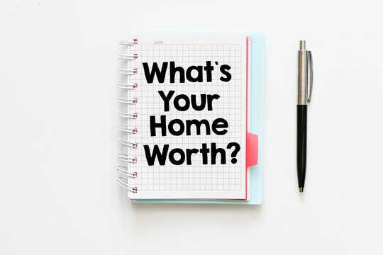 What`s your home worth?  text written in a notebook as a concept