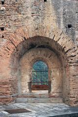 Fototapeta The tactical defense window of ancient Ruffo Castle, Scilla, Italy