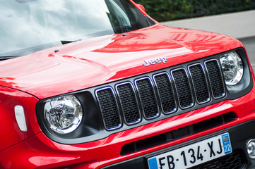 Mulhouse - France - 27 September 2019 - Front view of red jeep parked in the street