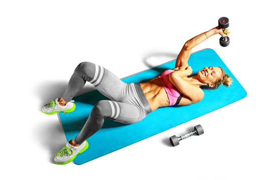 Professional fitness woman working out and stretching isolated on white background