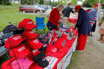 Hats supporting U.S. President Trump are displayed for sale at the Chicken Burn in Milwaukee