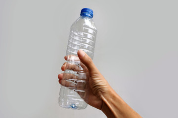 hand holding empty used plastic bottle;recycle concept