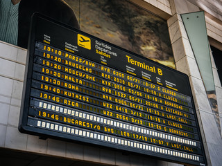 Barcelona, Spain - Jun 4, 2018: Low angle view of Modern electronic Airport departure board with schedule and flights number of diverse international airways  to Paris Brussels Moscow Malta, Kutaisi