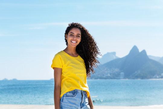 Smiling brazilian woman at Ipanema beach at Rio de Janeiro