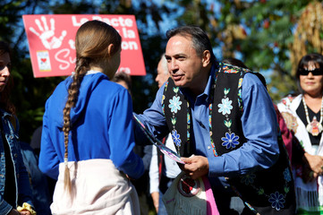 Climate change teen activist Greta Thunberg receives a gift from Assembly of First Nations National Chief Perry Bellegarde before joining a climate strike march in Montreal