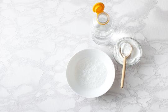 Foaming baking soda in a bowl of vinegar