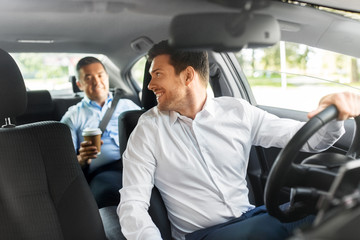 transportation, vehicle and people concept - male car driver talking to middle aged passenger