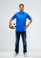 sport, leisure games and people concept - happy indian man or football fan with soccer ball over grey background