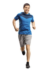 Young man jogging towards the camera