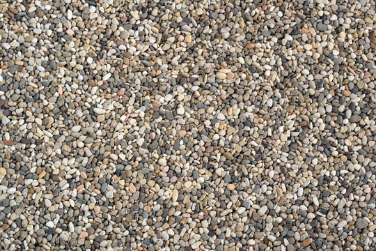 Dry aquarium sand texture background.  Small fine pea gravel grains. Close up view from the top.